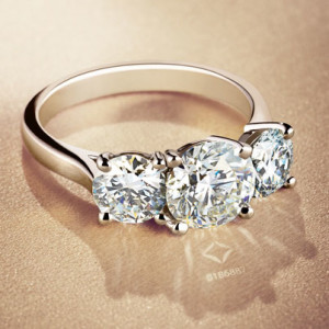 A ring featuring 3 Forevermark diamonds.